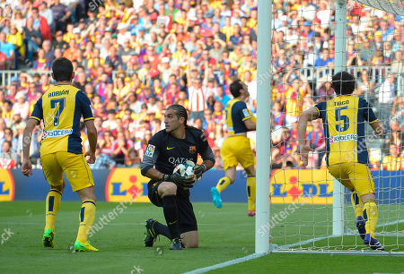 Jose Manuel Pinto Barcelona goalkeeper Jose Manuel Pinto kneels after Atletico's Diego Godin, from Uruguay, in background center, celebrates scoring his team's first goal during a Spanish La Liga soccer match between FC Barcelona and Atletico Madrid at the Camp Nou stadium in Barcelona, Spain, . At right, Atletico's Tiago Mendes, from Italy, and at left, Adrian Lopez