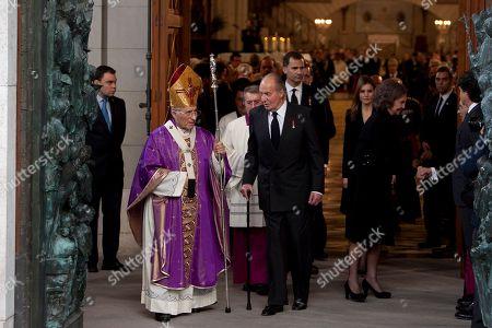Antonio Maria Rouco Varela, King Juan Carlos of Spain Spanish Cardinal Antonio Maria Rouco Varela, left, King Juan Carlos of Spain, centre, attends the State Funeral for Adolfo Suarez in Madrid, Spain