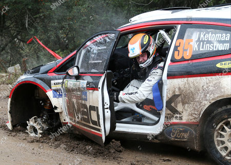 Jari Ketomaa Driver Jari Ketomaa of Finland gets out of his damaged Ford Fiesta after blowing a front tire during stage three on the first day of the FIA WRC Argentina Rally in Agua de Oro, Argentina