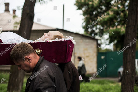Mourners carry the coffin of Alexey Vorobyov, a civilian killed by Ukraine National Guard during an operation against pro Russian activist last Friday in Mariupol, during his funeral in Mariupol, Ukraine, . Pro-Russia insurgents in eastern Ukraine declared independence Monday, a day after holding a hastily arranged referendum vote on separatism that Ukraine's government and its western allies said violated international law