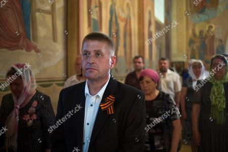 Vyacheslav Ponomarev Vyacheslav Ponomarev, center, the self-proclaimed mayor of Slovyansk, attends a Sunday's Orthodox service in Slovyansk, eastern Ukraine, . Lawmakers and officials from eastern Ukraine on Saturday poured criticism on the fledging central government, accusing it of ignoring legitimate grievances of the regions which have been overrun by pro-Russia militia fighting for independence