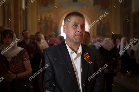 Vyacheslav Ponomarev Vyacheslav Ponomarev, the self-proclaimed mayor of Slovyansk attends a Sunday's Orthodox service in Slovyansk, eastern Ukraine, . Lawmakers and officials from eastern Ukraine on Saturday poured criticism on the fledging central government, accusing it of ignoring legitimate grievances of the regions which have been overrun by pro-Russia militia fighting for independence