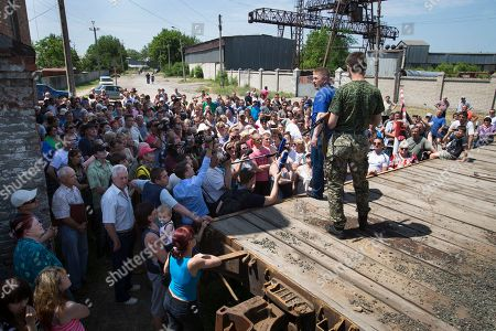 Vyacheslav Ponomarev Vyacheslav Ponomarev, foreground second right, the self-proclaimed mayor of Slovyansk speaks to local citizens whose homes were ruined in a shelling as his armed bodyguard stands behind his back in Slovyansk, eastern Ukraine, . On Tuesday, the rebels continued to exchange fire with government forces on the outskirts of the eastern city of Slovyansk, which has been the epicenter of clashes. Residents of Slovyansk sounded exasperated and angry with both the warring sides