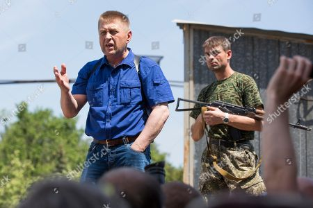 Vyacheslav Ponomarev Vyacheslav Ponomarev, left, the self-proclaimed mayor of Slovyansk speaks to local citizens whose homes were ruined in a shelling in Slovyansk, eastern Ukraine, . On Tuesday, the rebels continued to exchange fire with government forces on the outskirts of the eastern city of Slovyansk, which has been the epicenter of clashes. Residents of Slovyansk sounded exasperated and angry with both the warring sides