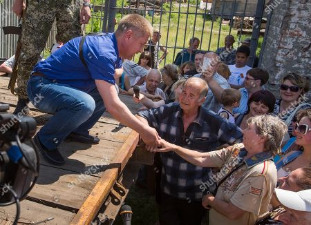 Vyacheslav Ponomarev Vyacheslav Ponomarev, left, the self-proclaimed mayor of Slovyansk, shakes hands with a woman during his meeting with local citizens whose homes were ruined in a shelling in Slovyansk, eastern Ukraine, . On Tuesday, the rebels continued to exchange fire with government forces on the outskirts of the eastern city of Slovyansk, which has been the epicenter of clashes. Residents of Slovyansk sounded exasperated and angry with both the warring sides