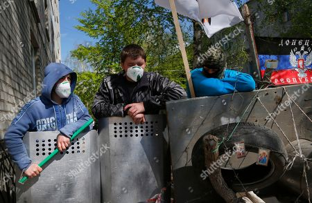 Pro-Russian protesters guard barricades in Slovyansk, eastern Ukraine, . Vyacheslav Ponomaryov the self-proclaimed mayor of Slovyansk in eastern Ukraine is appealing to Russia to send in peacekeeping troops after a shootout at checkpoint near the city manned by pro-Russia insurgents