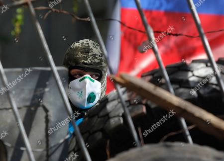 Stock Image of A pro-Russian protester guards barricades in Slovyansk, eastern Ukraine, . Vyacheslav Ponomaryov the self-proclaimed mayor of Slovyansk in eastern Ukraine is appealing to Russia to send in peacekeeping troops after a shootout at checkpoint near the city manned by pro-Russia insurgents