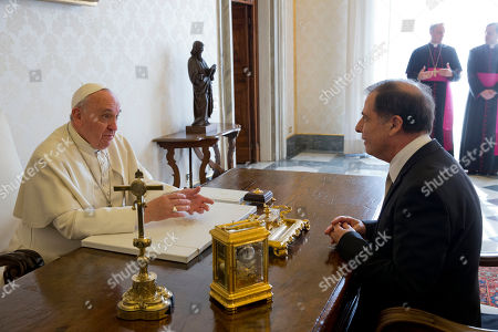 Pope Francis talks with Malta's President George Abela during a private audience in the Pontiff's studio, at the Vatican