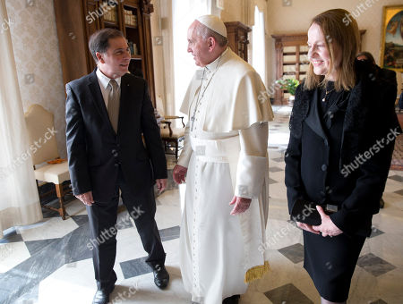 Pope Francis talks with Malta's President George Abela, left, and his wife Margaret during a private audience in the Pontiff's studio, at the Vatican