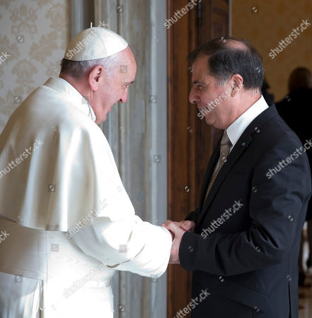 Stock Image of Pope Francis shakes hands with Malta's President George Abela during a private audience in the Pontiff's studio, at the Vatican