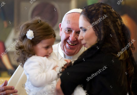 Stock Picture of Pope Francis smiles at Giorgia May, left, and Maria Abela, granddaughter and daughter of Malta's President George Abela, during a private audience in the Pontiff's studio, at the Vatican