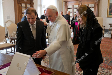 Pope Francis exchanges gifts with Malta's President George Abela, left, and his wife Margaret during a private audience in the Pontiff's studio, at the Vatican