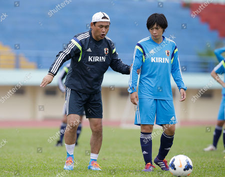 Norio Sasaki, Takase Megumi Japan team coach Norio Sasaki, left, talks to his player Takase Megumi during a training session at the AFC Women's Asian Cup soccer tournament at Army Stadium in Ho Chi Minh City, Vietnam, . Japan will play against Australia in their final match on Sunday