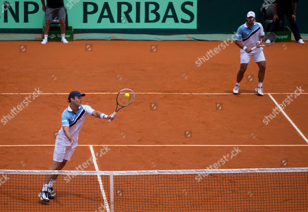 Horacio Zeballos, Eduardo Schwank Argentina's Horacio Zeballos, left, returns the ball to Italy's Fabio Fognini and Simone Bolelli as his teammate Eduardo Schwank looks on during their Davis Cup doubles match in Mar del Plata, Argentina