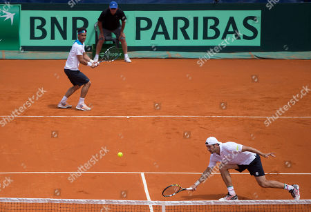 Simone Bolelli, Fabio Fognini Italy's Simone Bolelli, right, returns the ball to Argentina's doubles team Horacio Zeballos and Eduardo Schwank as his teammate Fabio Fognini look on at left during their Davis Cup doubles match in Mar del Plata, Argentina