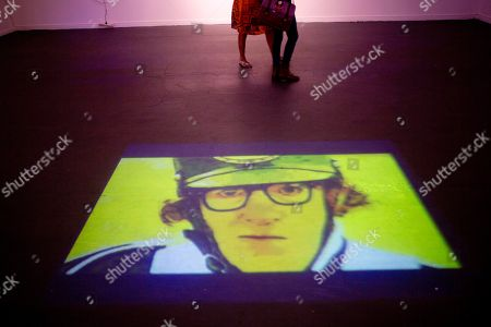 "An image of Woody Allen is projected on the floor at an art exhibit titled ""Queremos tanto a Woody,"" or ""We so love Woody"" by Argentine artist Hugo Echarri in Buenos Aires, Argentina, . The exhibit in honor of Allen was inaugurated just days after the artist faced renewed accusations that he molested Dylan Farrow, his then-7-year-old adopted daughter in 1992"