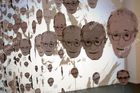 "Images in the likeness of U.S. director Woody Allen hang at an art exhibit titled ""Queremos tanto a Woody,"" or ""We so love Woody"" by Argentine artist Hugo Echarri in Buenos Aires, Argentina, . The exhibit in honor of Allen was inaugurated just days after the artist faced renewed accusations that he molested Dylan Farrow, his then-7-year-old adopted daughter in 1992"