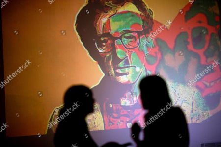 "An image of U.S. director Woody Allen is projected on a wall at an art exhibit titled ""Queremos tanto a Woody,"" or ""We so love Woody"" by Argentine artist Hugo Echarri in Buenos Aires, Argentina, . The exhibit in honor of Allen was inaugurated just days after the artist faced renewed accusations that he molested Dylan Farrow, his then-7-year-old adopted daughter in 1992"