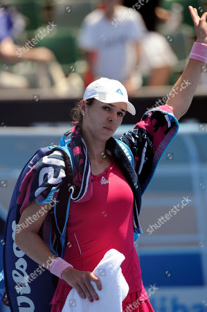 Galina Voskoboeva of Kazakhstan walks off the court after her loss to Carla Suarez Navarro of Spain during their second round match against at the Australian Open tennis championship in Melbourne, Australia