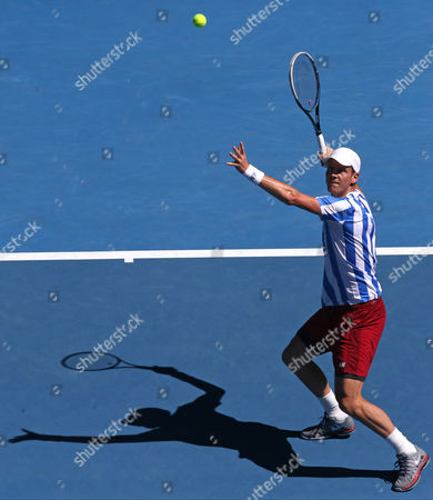 Tomas Berdych of the Czech Republic looks at the ball for a smash to David Ferrer of Spain during their quarterfinal at the Australian Open tennis championship in Melbourne, Australia