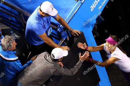 Li Na of China celebrates with her husband Jiang Shan, center top, and support team members after defeating Dominika Cibulkova of Slovakia during their women's singles final at the Australian Open tennis championship in Melbourne, Australia
