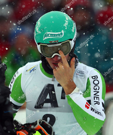 Felix Neureuther of Germany removes snow from his mask after completing the first run of an alpine ski men's World Cup Slalom in Kitzbuehel, Austria