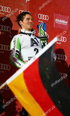 Felix Neureuther of Germany smiles on the podium after winning an alpine ski, men's World Cup slalom, in Kitzbuehel, Austria, . Felix Neureuther won the slalom of the classic Hahnenkamm event in heavy snow on Friday after first-run leader Marcel Hirscher failed to finish