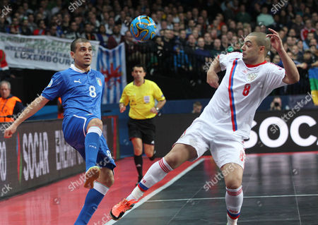 Vampeta, Eder Lima Russia's Eder Lima, right, is challenged by Italy's Vampeta, during the UEFA Futsal EURO final match at the Sportpaleis in Antwerp, Belgium, . Italy won the final