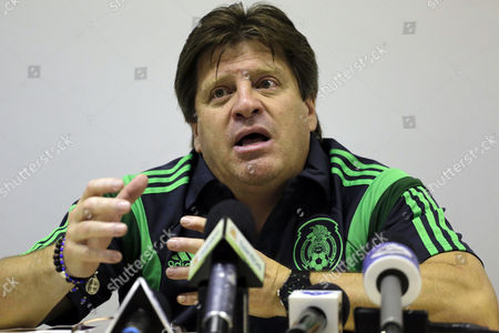 Miguel Herrera, Hector Gonzalez Mexico's head soccer coach Miguel Herrera, right, gives a press conference in Santos, Brazil, . At left is Hector Gonzalez, director of Mexico's national teams. Herrera and Gonzalez visited the Rei Pele training center in Santos where their team will train during the World Cup tournament