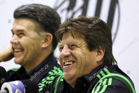Miguel Herrera, Hector Gonzalez Mexico's head soccer coach Miguel Herrera, right, laughs during a press conference in Santos, Brazil, . At left is Hector Gonzalez, director of Mexico's national teams. Herrera and Gonzalez visited the Rei Pele training center in Santos where their team will train during the World Cup tournament