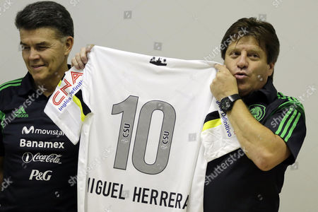 Miguel Herrera, Hector Gonzalez Mexico's head soccer coach Miguel Herrera holds up a Santos' soccer team jersey with his name on it at a press conference in Santos, Brazil, . At left is Hector Gonzalez, director of Mexico's national teams. Herrera and Gonzalez visited the Rei Pele training center in Santos where Mexico's soccer team will train during the World Cup tournament