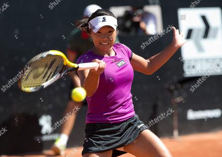 Stock Picture of Kurumi Nara Kurumi Nara of Japan, returns to Klara Zakopalova of the Czech Republic during the finals at the Rio Open tennis tournament in Rio de Janeiro, Brazil, Sunday, Feb.23, 2014