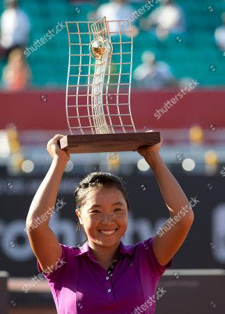 Kurumi Nara Kurumi Nara of Japan, holds up her trophy after defeating Klara Zakopalova of the Czech Republic at the Rio Open tennis tournament in Rio de Janeiro, Brazil, Sunday, Feb.23, 2014