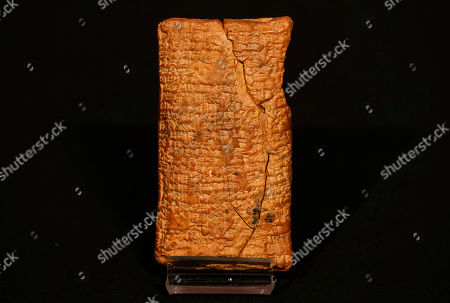 The 4000 year old clay tablet containing the story of the Ark and the flood stands on display at the British Museum in London during the launch of the book 'The Ark Before Noah' by Irving Finkel, curator in charge of cuneiform clay tablets at the British Museum, . The book tells how he decoded the story of the Flood and offers a new understanding of the Old Testament's central narratives and how the flood story entered into it
