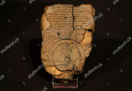 Babylonian 'Map of the World' tablet stands on display at the British Museum in London during the launch of the book 'The Ark Before Noah' by Irving Finkel, curator in charge of cuneiform clay tablets at the British Museum, . The book tells how he decoded the story of the Flood and offers a new understanding of the Old Testament's central narratives and how the flood story entered into it