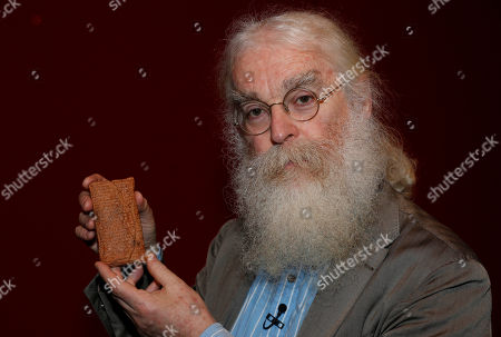 Irving Finkel Irving Finkel, curator in charge of cuneiform clay tablets at the British Museum, poses with the 4000 year old clay tablet containing the story of the Ark and the flood during the launch of his book 'The Ark Before Noah' at the British Museum in London, . The book tells how he decoded the story of the Flood and offers a new understanding of the Old Testament's central narratives and how the flood story entered into it