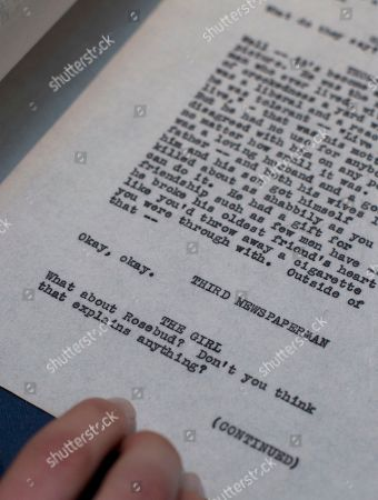 """The last page, in this version of the incomplete script, with the last lines of the then originally titled 'American' or as it is now known 'Citizen Kane' which was Orson Well working copy of the script held by an employee of Sotheby's auction house in London, . Orson Welles' personal draft script for """"Citizen Kane"""" is up for sale _ from the collection of an American almost as wealthy as the movie's monstrous newspaper mogul, though considerably more private. The script, which has an estimated price of 15,000 pounds to 20,000 pounds ($25,000 to $33,000), is part of a sale of more than 1,000 items owned by the late Stanley Seeger, an affluent collector of everything from Old Masters and contemporary art to historical oddities"""