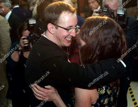 Nathan Filer, Emily Filer Costa Book of the Year winning author Nathan Filer, left, hugs his wife Emily after winning the prize for his book, The Shock of the Fall, during the award ceremony in London