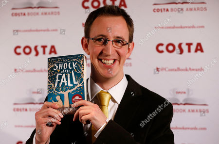 Nathan Filer Costa Book of the Year shortlisted author Nathan Filer poses with his book The Shock of the Fall during the award ceremony in London