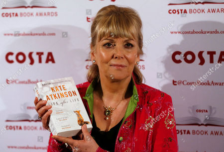 """Kate Atkinson Costa Book of the Year shortlisted author Kate Atkinson poses with her book """"Life After Life"""" during the award ceremony in London"""