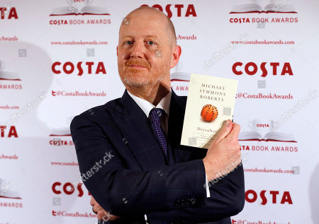 Stock Picture of Michael Symmons Roberts Costa Book of the Year shortlisted author Michael Symmons Roberts poses with his book Drysalter during the award ceremony in London