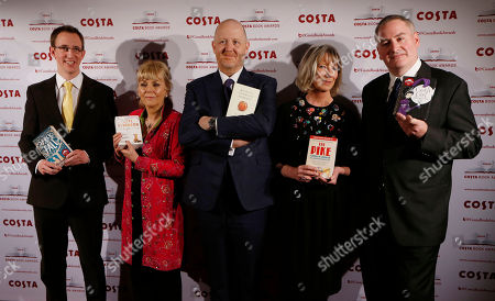 Stock Photo of Nathan Filer, Kate Atkinson, Michael Symmons Roberts, Lucy Hughes-Hallett, Chris Riddell Costa Book of the Year short listed authors, from left, Nathan Filer, Kate Atkinson, Michael Symmons Roberts, Lucy Hughes-Hallett and Chris Riddell pose with their books during the award ceremony in London