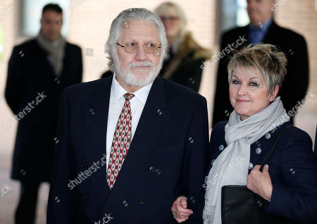 British veteran disc jockey Dave Lee Travis accompanied by his wife Marianne Griffin, leaves Southwark Crown Court in London, after being acquitted of 12 charges of indecent assault. The 68-year-old DJ denied the charges of assaulting young women over a period of three decades