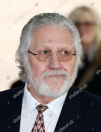 British veteran disc jockey Dave Lee Travis talks to members of the media outside the Southwark Crown Court in London, after being acquitted of 12 charges of indecent assault. The 68-year-old DJ denied the charges of assaulting young women over a period of three decades