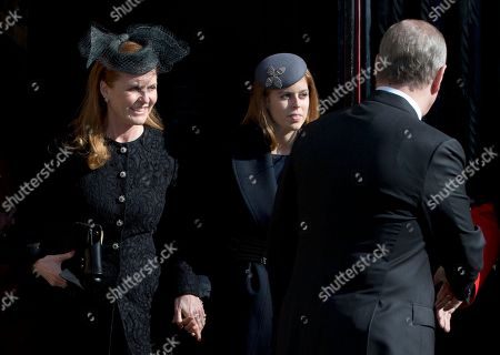 Sarah Ferguson, left, holds hands with her daughter Princess Beatrice as they leave after attending the Sir David Frost memorial service at Westminster Abbey in London,Thursday, March, 13, 2014. British broadcaster David Frost died in August 2013, one of his most famous interviews was with President Richard Nixon
