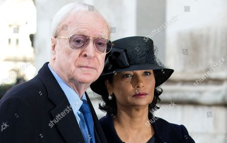 British actor Michael Caine and his wife Shakira arrive for the Sir David Frost memorial service at Westminster Abbey in London,Thursday, March, 13, 2014. British broadcaster David Frost died in August 2013, one of his most famous interviews was with President Richard Nixon