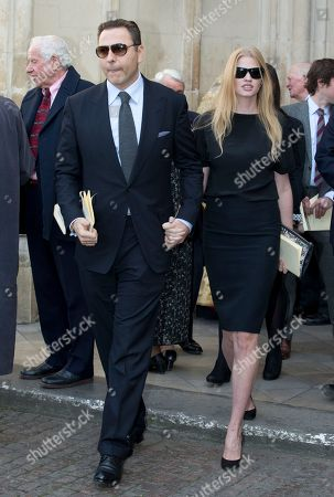 David Walliams and his wife Lara Stone leave after attending arrive the Sir David Frost memorial service at Westminster Abbey in London,Thursday, March, 13, 2014. British broadcaster David Frost died in August 2013, one of his most famous interviews was with President Richard Nixon