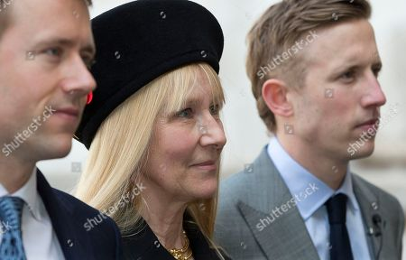 Carina Fitzalan-Howard, centre, wife of David Frost arrives with two of their sons for his memorial service at Westminster Abbey in London, . British broadcaster David Frost died in August 2013, one of his most famous interviews was with President Richard Nixon