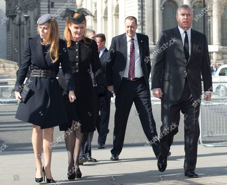 Prince Andrew, right, with his former wife Sarah Ferguson and their daughter Princess Beatrice arrive for the Sir David Frost memorial service at Westminster Abbey in London, . British broadcaster David Frost died in August 2013, one of his most famous interviews was with President Richard Nixon