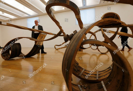 Richard Deacon British artist and Turner Prize winner Richard Deacon poses with his sculpture 'Out of Order 2003' at Tate Britain art gallery in London during the launch of the exhibition of his artworks at the gallery